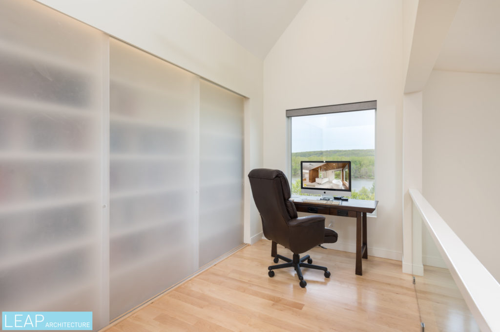 This modern master suite includes a home office nook and hidden storage space.